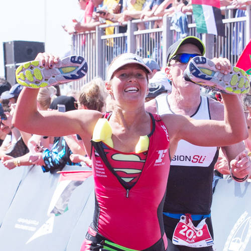 Woman feeling victory at fitness first tri event