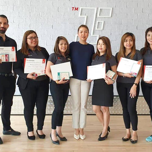 Fitness First employees holding their certificates
