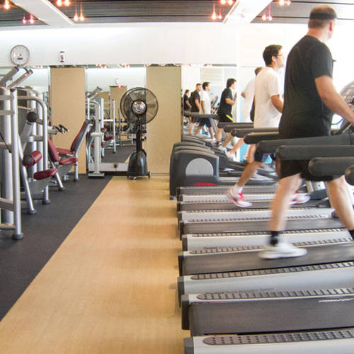 Fitness First Town center members running on treadmills